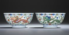 A fine and rare pair of wucai 'Dragon and Phoenix' bowls, Kangxi six-character marks within double circles and of the period (1662-1722). Photo Christie's Image Ltd 2014