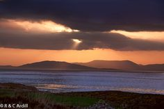 Bantry Bay at Sunset with Bear Island in the left background and Hungry Hill in the distance. West Cork