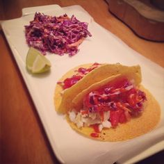 #fishtacos, so easy, so healthy & so delicious. Paired here with a clean coleslaw recipe.  Squeeze a lime over raw #halibut (or tilapia), add a dash of cumin, minced garlic, salt & pepper. Put in the fridge for 15 mins so it marinates. Then cut up tomato, onion & cilantro & cover with lots of lime and let it marinate. Heat up your fish at 350 degrees until flaky & pile all the fixings, including mashed avocado on your corn tortillas. Hot sauce anyone? #cleaneating #eatclean @healthfoodsnob