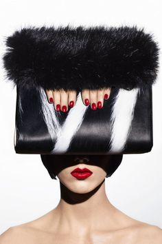 4 best accessories that will jump start your fall season: Animal Magnetism; Calvin Klein Collection clutch.