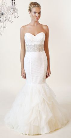 Winnie Couture This mermaid with layered tulle skirt, a beaded belt with sweetheart neckline.