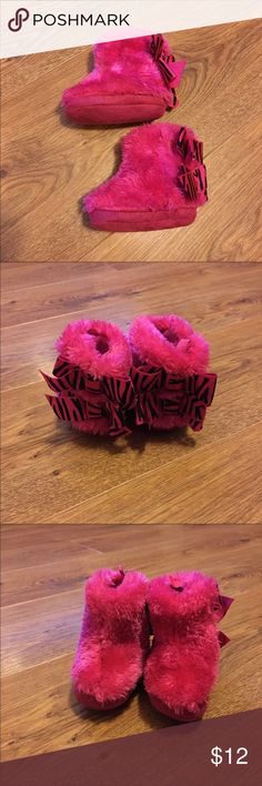 Super cute pink fur boots for baby These boots are in perfect condition with suede soles, Velcro sides, and double bows on the backs.  Size 3-6 months. Stepping Stones brand. stepping stones Shoes Boots