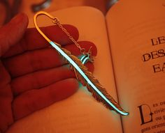 Feather Bookmark with Little Hummingbird which are both Glow In the Dark and Solar Charged. Great for night readers.  Hey, I found this really awesome Etsy listing at https://www.etsy.com/listing/176059294/feather-bookmark-with-little-hummingbird