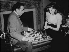 Bogart and Bacall playing Chess at home, 1949