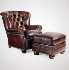 Every library has to have a brown overstuffed leather chair with a matching foot stool to sit by the fire...