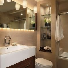 small bathroom. Like the layout and use of space ~like the buit in cabinet in bathroom to save space
