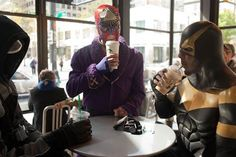 Phoenix Jones at Starbucks, gearing up for May Day