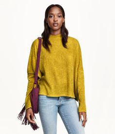Soft, wide-cut, fine-knit sweater a turtleneck, dropped shoulders, and long sleeves.