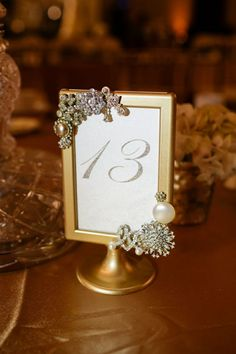 Custom vintage brooch table numbers for rent - St. Vintage Table Numbers, Framed Table Numbers, Wedding Table Numbers, Wedding Seating, Wedding Reception Decorations, Wedding Centerpieces, Wedding Tables, Ikea Wedding, Wedding Frames
