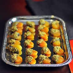 Next party, doing THIS. Apricots covered with chocolate and pistashios.