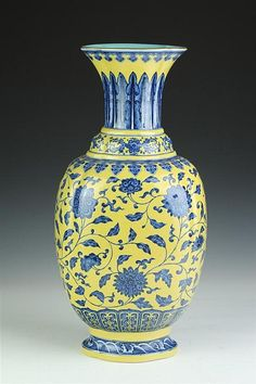 CHINESE BLUE AND YELLOW PORCELAIN VASE, Qianlong underglazed blue seal mark. Floral decoration on yellow ground, turquoise interior and base. - 19 in. high.