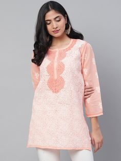 Ada Hand Embroidered Peach Cotton Lucknow Chikan Top – A273726 has a straight long finish along with straight hems. This is readymade prewashed kurti #Ada #Adachikan #chikankari #handcrafted #handembroidered #cotton #shopnow