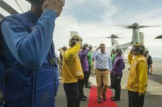 U.S. Defense Secretary Ash Carter salutes U.S. sailors during a visit aboard the USS Theodore Roosevelt at sea, Nov. 5, 2015. Carter toured the aircraft carrier with Malaysian Defense Minister Hishammuddin Hussein. DoD photo by Air Force Senior Master Sgt. Adrian Cadiz