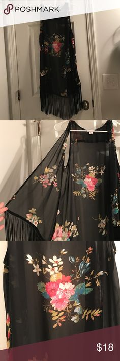 NWOT Fringe Sleeveless Kimono So cute!! Sheet sleeveless kimono with fringe at bottom. Brand new never worn- does not come with tags. True to size. Floral pattern. No trades Xhilaration Tops