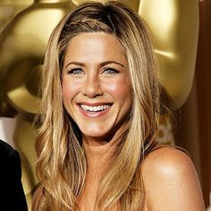 Jennifer Aniston's braid and waves with blonde highlights