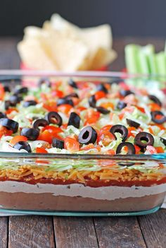 7 Layer Dip - Emily Bites - - This easy 7 Layer Dip is perfect for parties, no oven required! Layers of Mexican flavor, just 111 calories or 3 Green, 2 Blue or 2 Purple myWW SmartPoints. 7 Layer Taco Dip, 7 Layer Dip Recipe, Layered Taco Dip, Seven Layer Dip, 7 Layer Bean Dip, Easy Taco Dip, 7 Layer Mexican Dip, Mexican Bean Dip, Cold Taco Dip