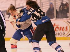 Rochester's Frederick Roy, left, and Lake Erie's Mitchell Heard square off in the first period.