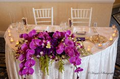 Half-moon Sweet heart table with floral arrangement