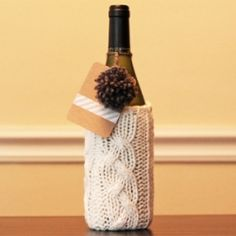 Recycle an old sweater to create a knit gift bag for a bottle of wine