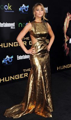"""""""At the 2012 L.A. premier of The Hunger Games, Lawrence looked literally ablaze in this gold Prabal Gurung gown with simmering cutouts.""""    Photos: Jennifer Lawrence's Fiery Fashion Evolution 