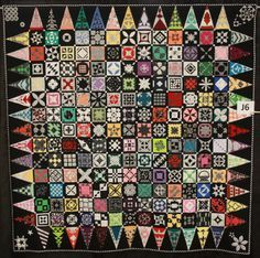 """""""Jane of Many Colors"""" by Chris White.  Dear Jane exhibit, 2013 Vermont Quilt Festival, photo by Threadmistress"""