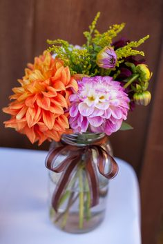 Simple dahlias in ribbon-tied jars