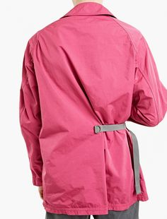 The kolor Belted Utility Jacket for SS17, seen here in pink.  A characteristically bold style from the Japanese label, this kolor jacket is crafted from a premium cotton-blend and features a unique belt detail to the waist. A relaxed style, it is finished with large pockets to the hips and one to the interior chest.