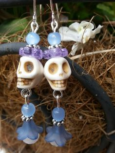 White skulls with lavender bead accent earrings.