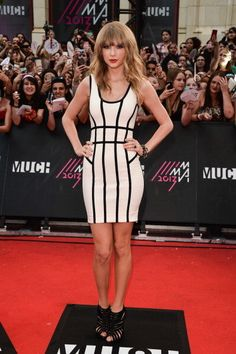 Taylor Swift tried the Bandage Dress Look & Nailed It! She rocked a striking Herve Leger dress at the MuchMusic Video Awards in Toronto on 6-16-2013 Swift, who took home the Favorite International Artist trophy of the night, showed off her toned curves in the tight-fitting gown — resulting in a distinctly mature but still perfectly respectable look. Caged sandals added yet another bit of super-stylish edge to the ensemble.