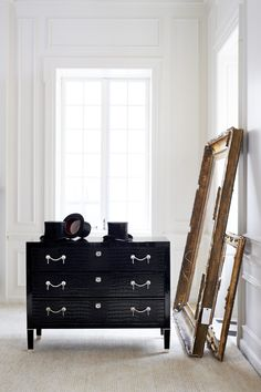 Built by hand and fitted with crocodile embossed black leather, the Brook Street Chest from Ralph Lauren Home