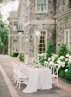 Romantic wedding inspiration in peach and ivory | white cross back dining chairs | refined rustic