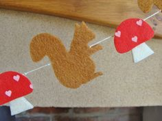 Decorations: Woodland Fairies Party - Red Squirrel Garland,Felt, with mushrooms. £12.00, via Etsy.