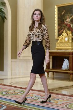 A classical look with leopard print shirt and black pencil skirt
