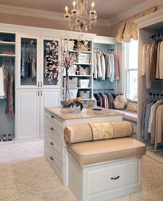 Not sure who designed this closet but it's lovely