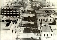 This 1956 view, taken from the top of the Threefoot Building, shows 22nd Avenue looking south. Before the construction of the James Melton Bridge, trains rolled through the downtown shopping area. Behind the train, to the right, is the Gulf, Mobile and Ohio Railroad Freight Terminal. Plans were under way to renovate the building for use as a railroad museum when it burned in 1995.
