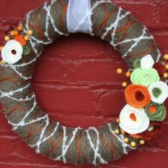 Yarn Felt Flower Wreath Tutorial.  Shows how to make the Felt Flowers
