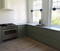Flat-front cabinets with recessed pulls from kitchen-front company Koak Design. Read on inIkea Kitchen Upgrade: 8 Custom Cabinet Companies for the Ultimate Kitchen Hack.