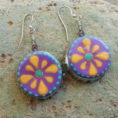 Handpainted bottle cap earrings by Rebecca Pavlik