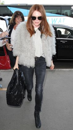 Julianne Moore wears concrete-colored skinny jeans by The Great, a striped t-shirt, and a fur jacket