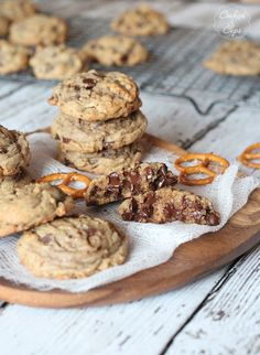 Salty Pretzel Chocolate Chip Cookies 1 cup butter, melted and browned 1 1/4 cup light brown sugar 2 eggs + 1 yolk 2 tsp vanilla 1 tsp baking soda 1/2 tsp salt 2 1/4 cups flour 1 1/2 cups crushed pretzels 2 cups chocolate chips