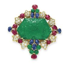 An emerald, diamond, sapphire and ruby brooch