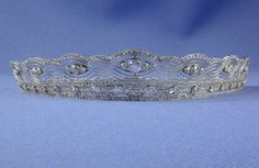 A light belle epoque diamond tiara, circa 1905. Designed as a lower diamond and platinum band, studded with 17 circular diamonds, and an upper band of platinum lattice work into which seven groups of three diamonds are set. This tiara was once on sale at S J Phillips site.