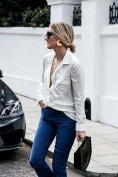 A collar blouse over jeans.