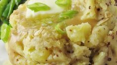 Light and fluffy mashed potatoes get a flavor boost from whole grain mustard in this easy-to-make side dish.