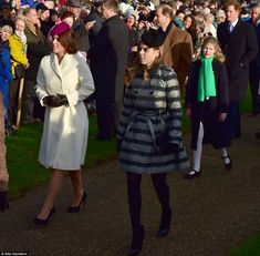 Stylish: Princess Eugenie added festive cheer to her outfit with a cranberry-coloured bere...