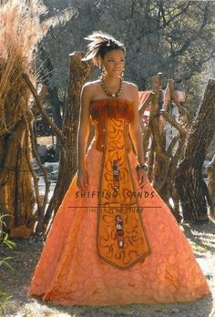 Shifting Sands Traditional African Zulu inspired orange taffeta ballgown with front mask beaded detail African Wedding Dress, African Dress, African Outfits, African Weddings, African Clothes, Zulu Traditional Wedding Dresses, African Traditional Wear, Ethnic Fashion, African Fashion