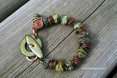 Lampwork Bracelet Olive Greens Copper Enameled by LeanneDesigns, via Etsy.