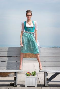 """- Tropical Jade and silver medium length dirndl Pleated skirt length is 26"""" from the waist - Traditional square neckline bodice with metallic sequin trim - Imported metal hardware with silver and gold"""