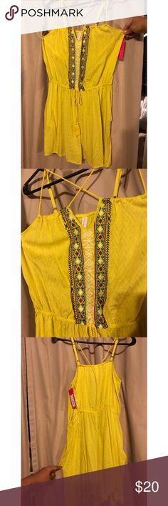 Aztec Romper Neon yellow with Aztec designs. Has pockets. Could be worn casual or dressed up. Never been worn and still has tags.. from Target Fashion Nova Dresses