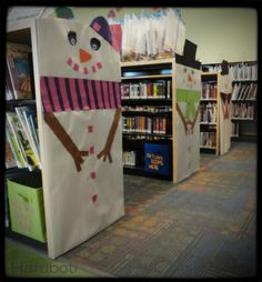 Decemberley!!! | Hafuboti.com | Fun snowpeople endcaps for kids to discover at the back of the library. Easy and full of fun impact.